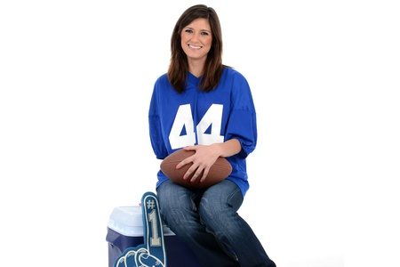 Adult womanl set against a white background with football Stock Photo - 19943814