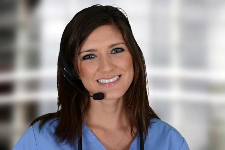 headset help: Female nurse working her job in a hospital