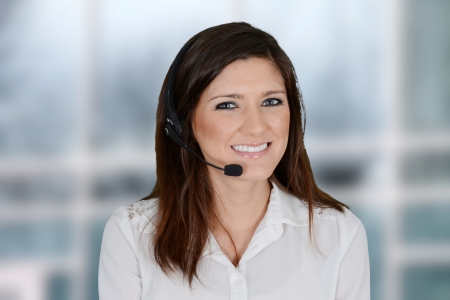 Young woman giving help as a customer service employee Stock Photo - 20443927