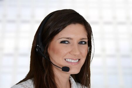 Young woman giving help as a customer service employee Stock Photo - 20443926