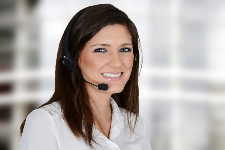 Young woman giving help as a customer service employee Stock Photo - 20443900