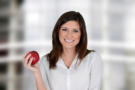 apple: Teacher with an apple at her school job