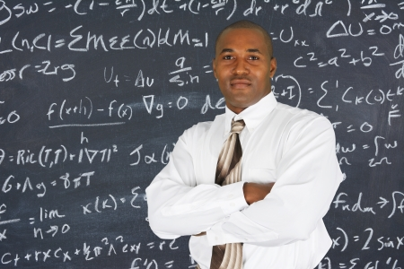 university professor: Teacher at school in the classroom ready for work Stock Photo