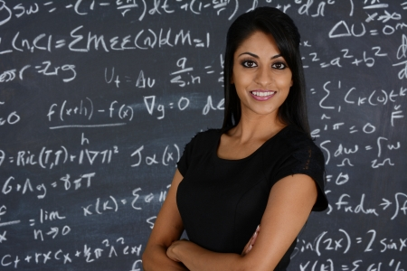 Teacher at school in the classroom ready for work photo
