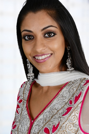 Smiling happy woman dressed in traditional clothing