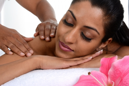 Woman getting a getting relaxing massage in salon photo