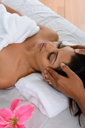 head massage: Woman getting a getting relaxing massage in salon Stock Photo