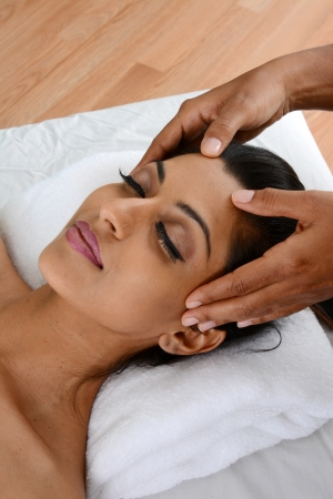 scalp: Woman getting a getting relaxing massage in salon Stock Photo