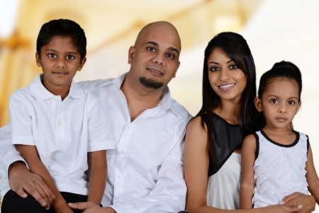 indian family: Family together inside of their new home