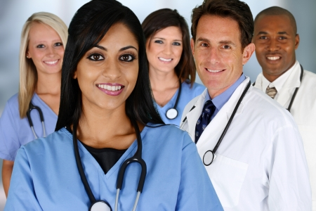 Group of doctors and nurses set in a hospital Stock Photo
