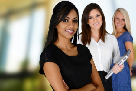 big smile: Businesswomen of all races working together in an office