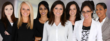 Businesswomen of all races working together in an office Stock Photo - 25868585