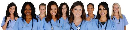 enfermeria: Grupo de enfermeras fija en un fondo blanco Foto de archivo