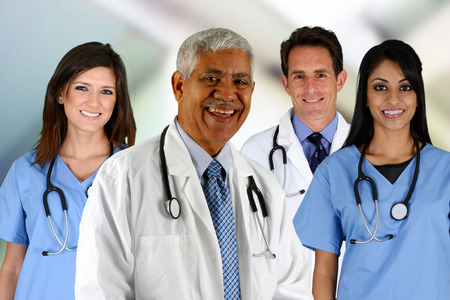health professionals: Group of doctors and nurses set in a hospital Stock Photo