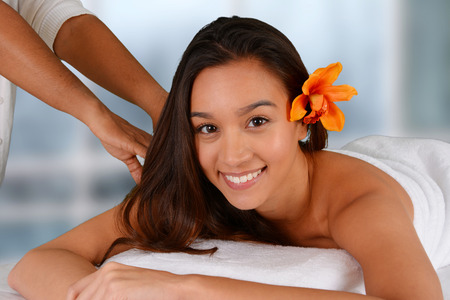 Woman getting a getting relaxing massage in salon Stock Photo - 28911116