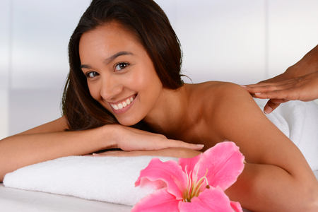 Woman getting a getting relaxing massage in salon Stock Photo - 28843944