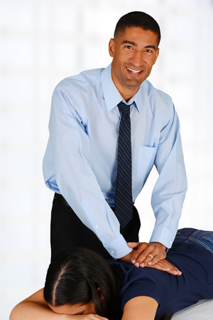 Male chiropractor working at his office with a patient Stock Photo - 29008212