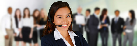 Young woman giving help as a customer service employee Stock Photo - 29380492