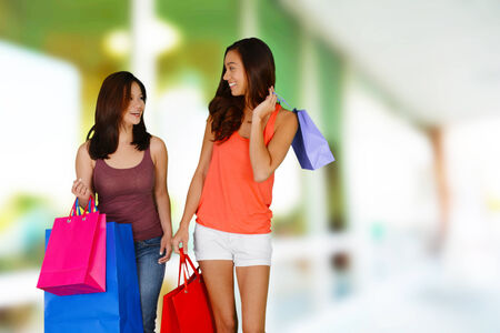 Teen girl shopping with bags with her friend photo