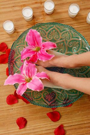 feet washing: Woman getting a getting relaxing massage in salon Stock Photo