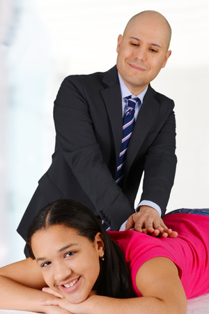 Male chiropractor working at his office with a patient Stock Photo - 29088805