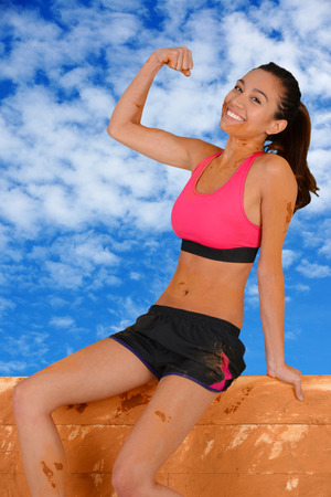 obstacle course: Woman competing in a mud run race