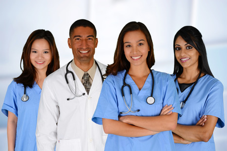 black nurse: Group of doctors and nurses set in a hospital Stock Photo