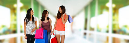 Women shopping with bags at the mall photo