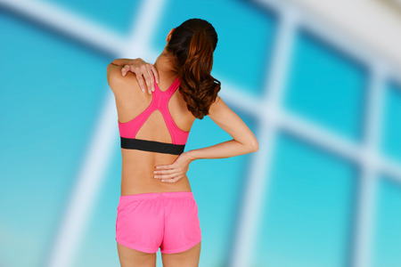 back ache: Woman working out and having some back pain Stock Photo