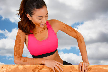 Woman competing in a mud run race Stock Photo - 29785970