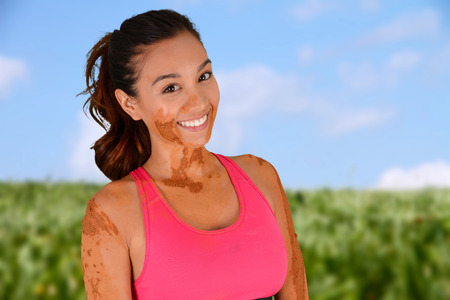 Woman competing in a mud run race Stock Photo - 29785973