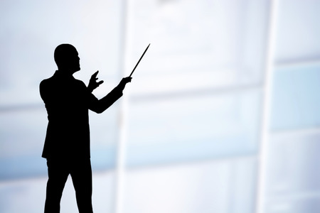 conducting: Man conducting musicians while playing a song