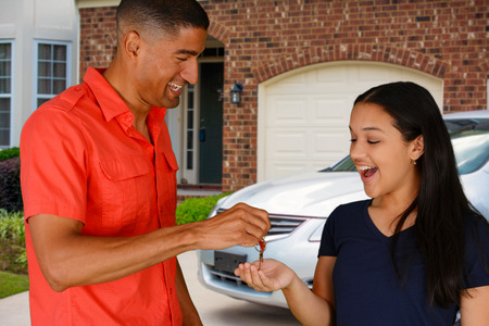Teen getting the keys to her new car Stock Photo - 30185589