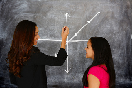 high class: Teacher at school in the classroom ready for work Stock Photo