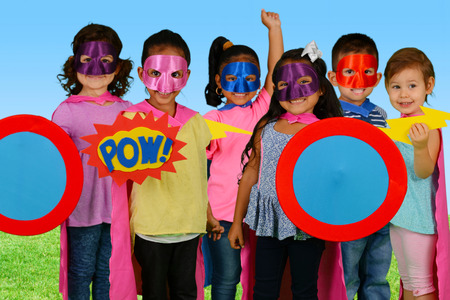 Group of children who are dressed up as superheroes photo