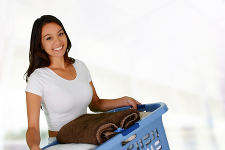 Woman who is doing laundry in her home photo
