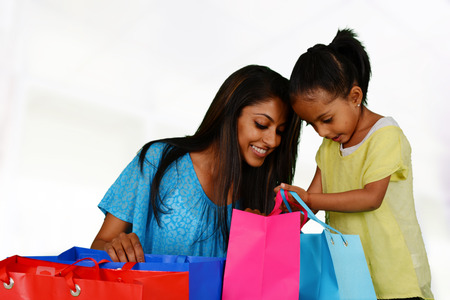 Woman shopping with bags at the mall Stock Photo