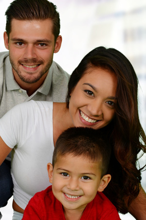 interracial marriage: Young family together inside of their home