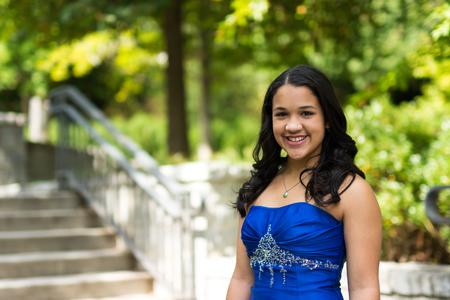 Teen girl wearing her formal Quinceanera dress photo