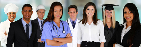 health professionals: Team of professionals all standing in an office