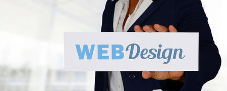 Young woman designing a website for her client