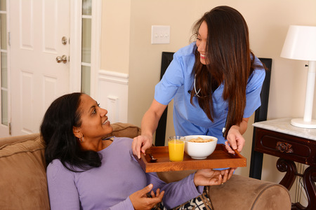 home care nurse: Home health care worker and an adult woman