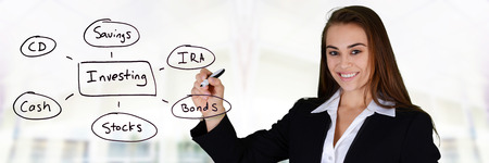 financial planner: Business woman with investing diagram Stock Photo