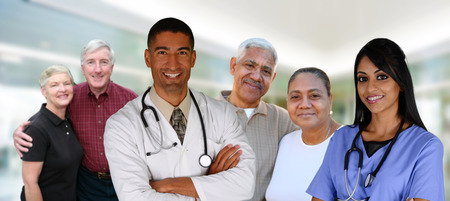Senior couples with their medical workers in a hospital photo