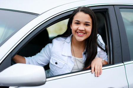 drivers: Teen in her new car going for a drive Stock Photo