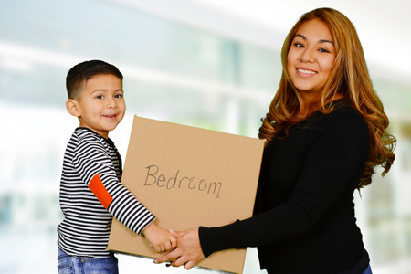 moving box: Mother and son who are moving into their home