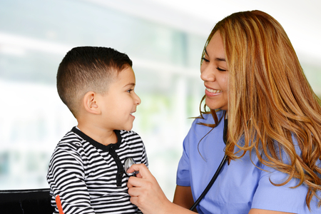 general pediatrician: Female nurse working at her office with a patient