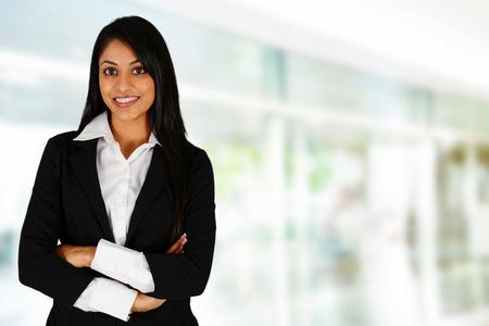 Businesswoman working at her office by herself Standard-Bild