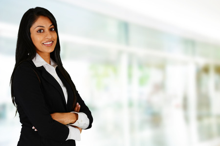 Businesswoman working at her office by herself Foto de archivo