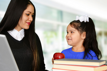 employment elementary school: Teacher at school in the classroom ready for work Stock Photo
